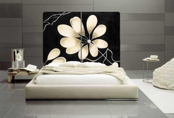 Ultra-luxury-modern-bedroom-interior-design-with-upholstery-white-bed-set-with-black-headboard-with-white-flowers
